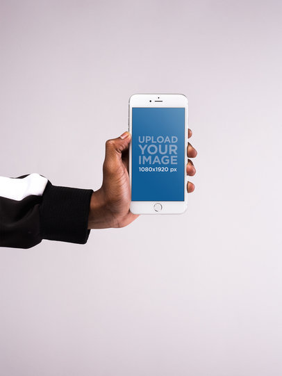 Mockup of an iPhone Held Against a White Surface 22134