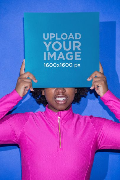 Vinyl Album Cover Mockup Featuring a Girl with a Hot Pink Zip Top Against an Azure Wall 22111