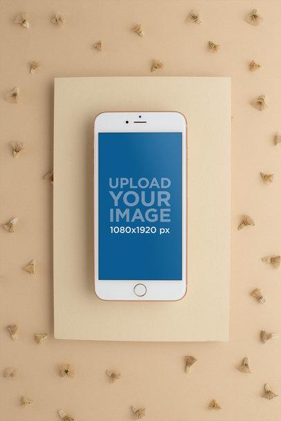 Gold iPhone Mockup Lying on a Rectangular Cardboard Surface 22017