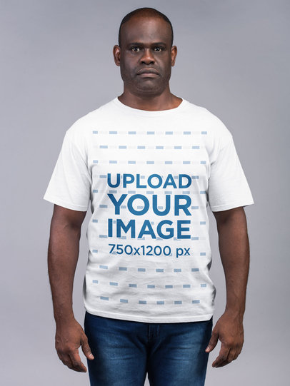 Mockup Featuring a Man Wearing T-Shirt and Jeans with a Serious Expression 21481