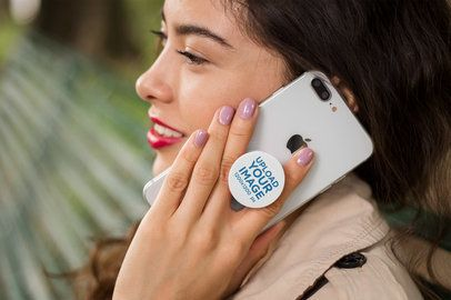 Phone Grip Mockup Held by a Woman Talking on the Phone 22074