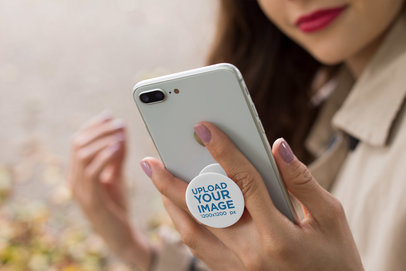 Mockup of a Phone Grip Held by a Woman 22076