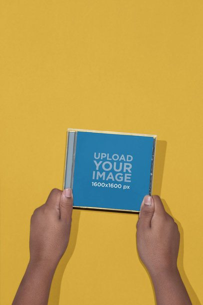 CD Mockup Held by Two Hands 22123