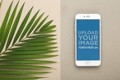 Silver iPhone 8 Plus Mockup Lying Next to Large Leaves 22184