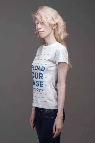 T-Shirt Mockup of a Serious Woman Standing on a Gray Background  21874