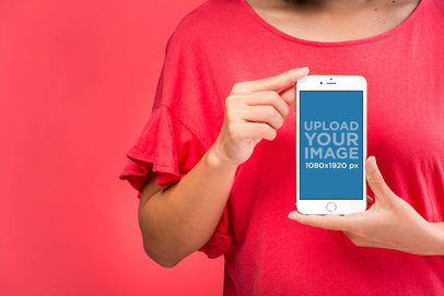 Mockup Featuring a Woman in a Red Top Showing an iPhone 8 Plus to the Camera 22166