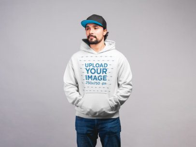 Pullover Hoodie Mockup Featuring a Man with a Beard Wearing a Hip-Hop Cap 21655