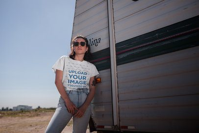 T-Shirt Mockup of a Woman Casually Leaning on an RV 20042