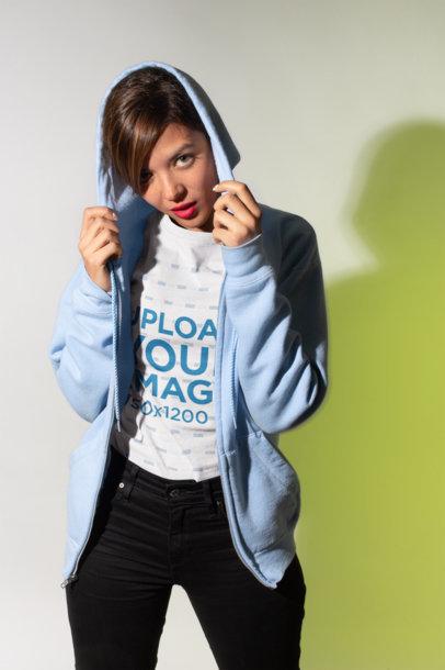 T-Shirt Mockup Featuring a Girl Wearing a Light Blue Zip-Up Hoodie 18582