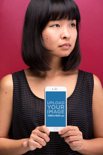 Mockup of an iPhone 8 Plus Held by a Woman With a Beauty Mark 22178