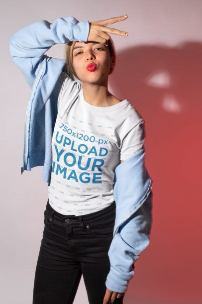 Tshirt Mockup Featuring a Girl Sending a Kiss in a Studio 18585