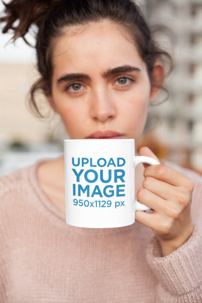 Mockup of a Coffee Mug Held by a Woman with a Messy Bun 22439