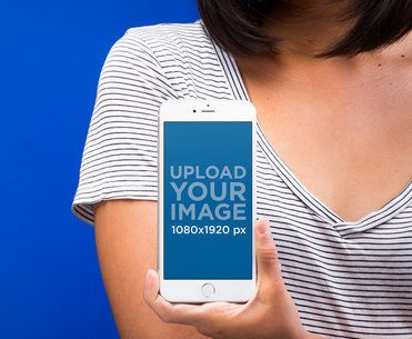 Mockup of a Silver iPhone 8 Held by a Woman Wearing a Striped Shirt 22177