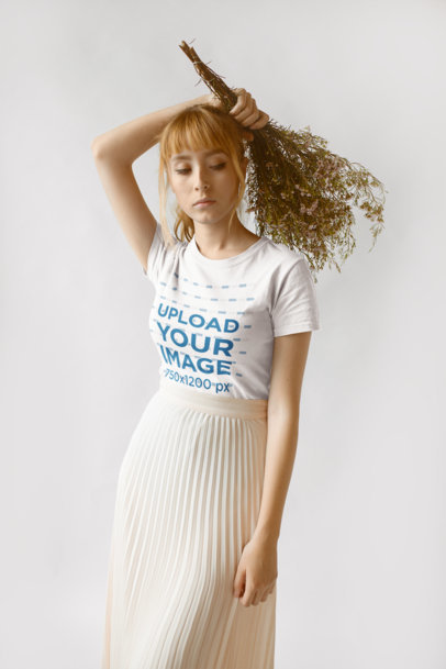 Tshirt Mockup of a Pretty Girl in a Chiffon Skirt Holding a Dried Bouquet 18380