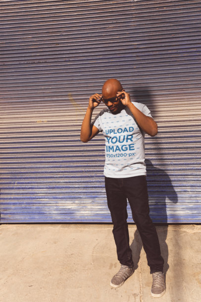 Tshirt Mockup of a Bald Man Posing with Sunglasses on a Sunny Day 207779