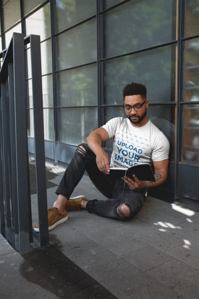 T-Shirt Mockup of a Cool Man with Beard Reading on the Floor 21355