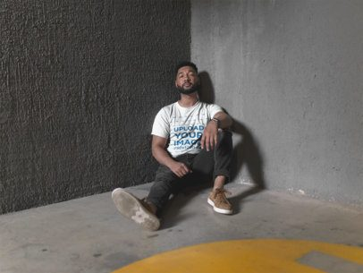 Crewneck Tee Mockup of a Bearded Man Sitting Against a Cement Wall  21349