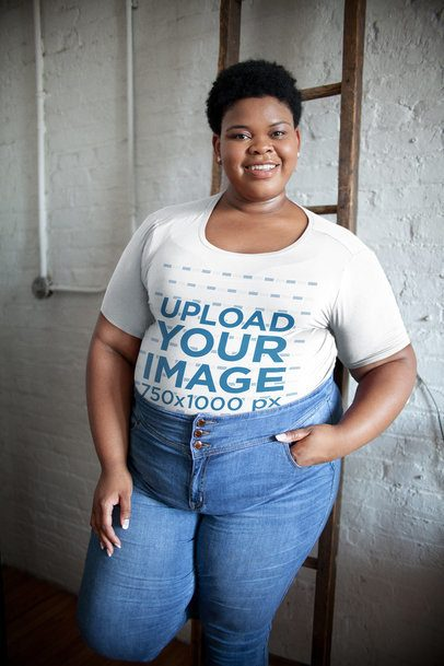 Mockup of a Woman Wearing a Plus Size T-Shirt Leaning on a Wooden Ladder 22578