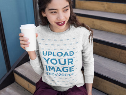 Crewneck Mockup of a Woman Holding a Paper Coffee Cup 18139