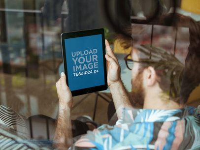 Mockup of an iPad Held by a Man with Glasses 22610