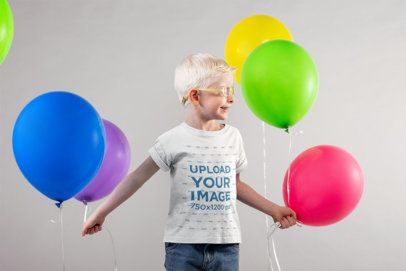 T-Shirt Mockup of a Young Cute Boy Holding Balloons 22042