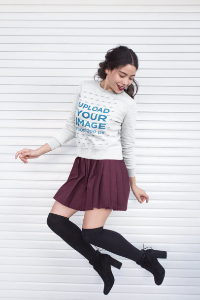 Sweatshirt Mockup Featuring a Girl in a Trendy Outfit Jumping 18142