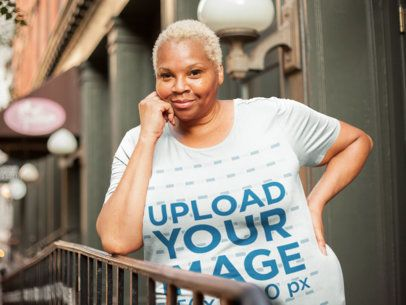 Mockup of a Woman Wearing a Plus Size T-Shirt Leaning Her Elbow on a Rail 22569