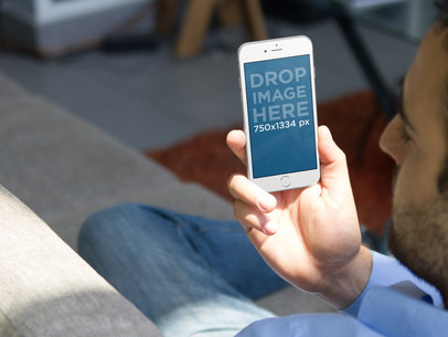 White iPhone 6 Mockup of Man at Home a2851