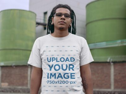T-Shirt Mockup of a Serious Man With Locks In Front of an Industrial Site 22058