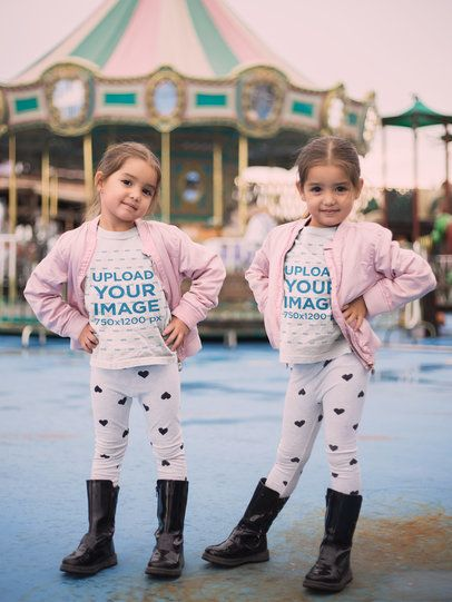 Mockup of Little Twin Girls Wearing T-Shirts by a Carousel 22530