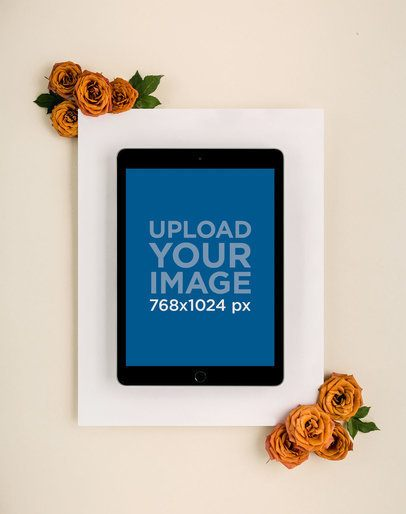 Mockup of a Space Gray iPad on a White Cardboard with Flowers 22550