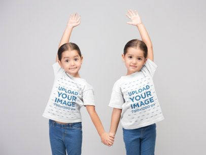 Mockup of Two Little Girls Playing while Wearing Crew Neck T-Shirts 22515