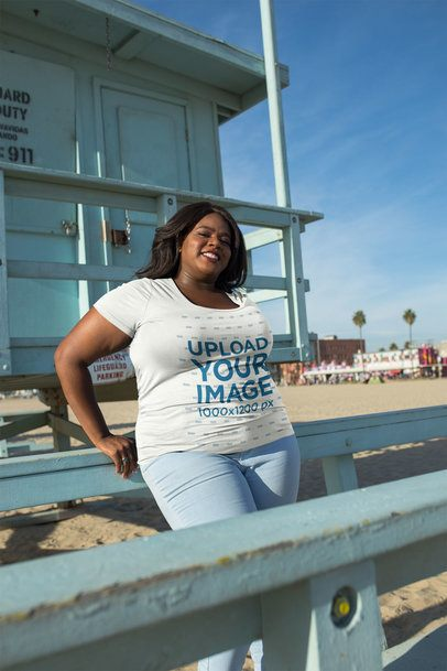 Mockup of a Woman Wearing a Plus Size T-Shirt Leaning on a Lifeguard Tower 18290