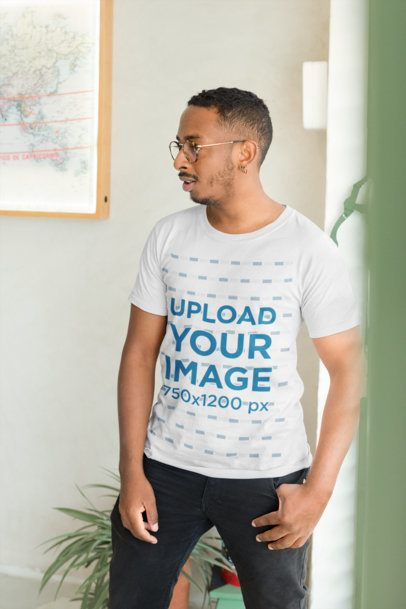 T-Shirt Mockup Featuring a Man with Glasses Inside his House 21037