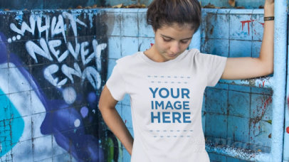 Smiling Young Woman at a Skate Park Wearing a Tshirt Video Mockup 12859
