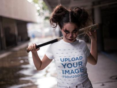 T-Shirt Mockup of a Woman Wearing Halloween Makeup and Staring at the Camera 22925