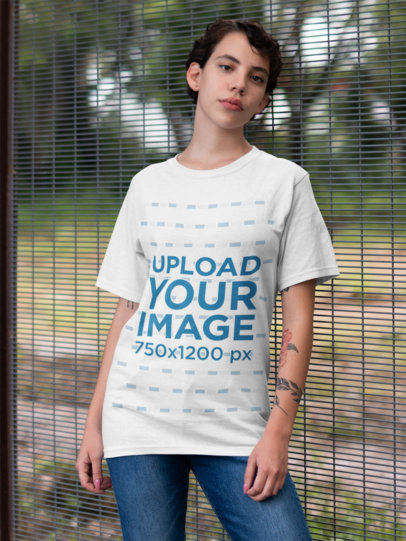 Round Neck Tee Mockup of a Girl Standing Against a Fence 22744