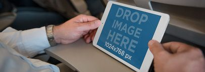 iPad Mockup Featuring a Businessman on a Plane a3200
