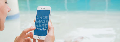 iPhone 6 Mockup Featuring a Woman Using her iPhone at the Pool a3203