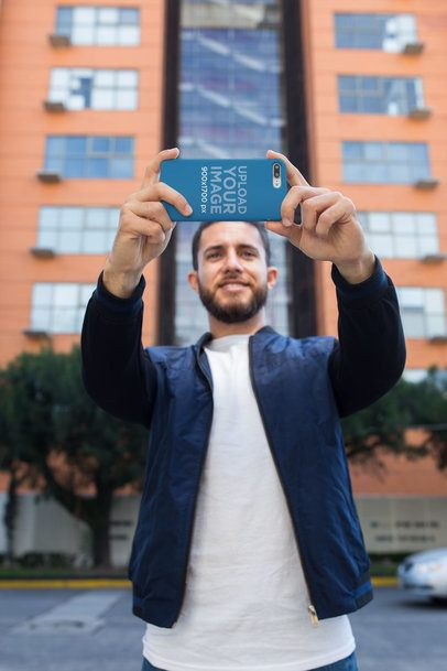 iPhone Case Mockup Featuring a Man Taking a Selfie 22870