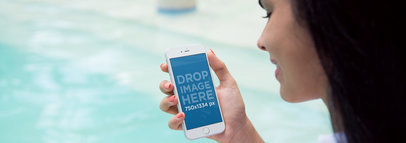 iPhone 6 Mockup of a Woman Holding an iPhone by the Pool a3211