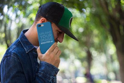 Phone Case Mockup of a Man Making a Call at a Park 22873