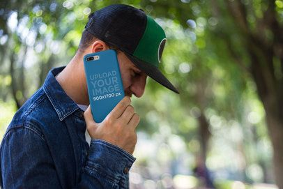 Phone Case Mockup of a Man Making a Call at a Park 22873