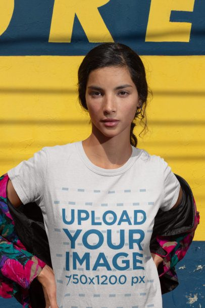 Round Neck Tee Mockup of a Girl Against a Blue and Yellow Background 18429