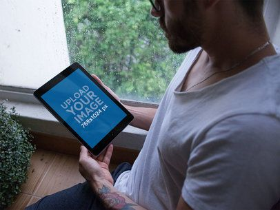 iPad Mockup Featuring a Man by a Rainy Window 22829