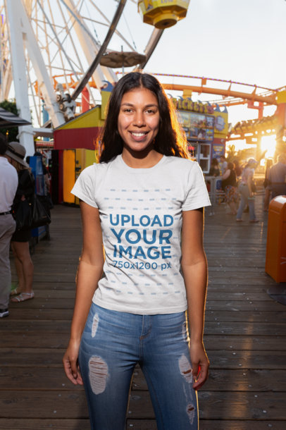 Mockup of a Smiling Girl Wearing a Tshirt at an Amusement Park 18216