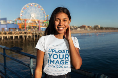 T-Shirt Mockup of a Woman on the Santa Monica Pier 18214