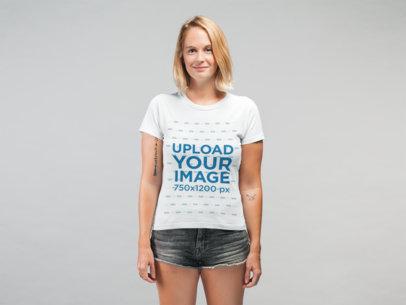 Mockup of a Smiling Girl Wearing a T-Shirt and Denim Shorts at a Studio 22326