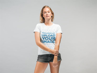 T-Shirt Mockup Featuring a Woman with Shorts in a Studio 22328