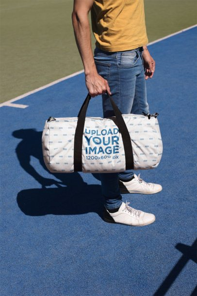 Mockup of a Man Carrying a Duffel Bag at a Court 23223
